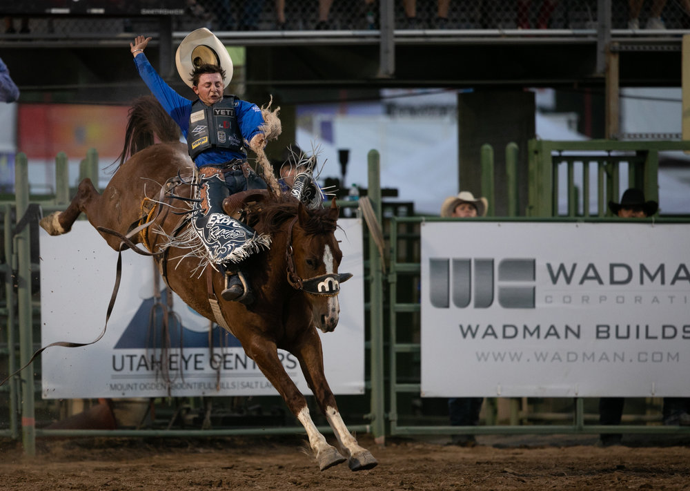 Rusty Wright of Milford, Utah, rides in the Saddle Bronc competition during the third night of the Ogden Pioneer Days Rodeo on Saturday, July 21, 2018.