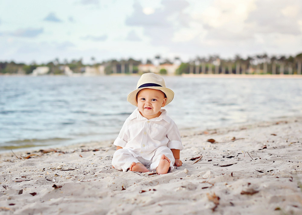 WEB-Noah little smirk w hat on beach.jpg