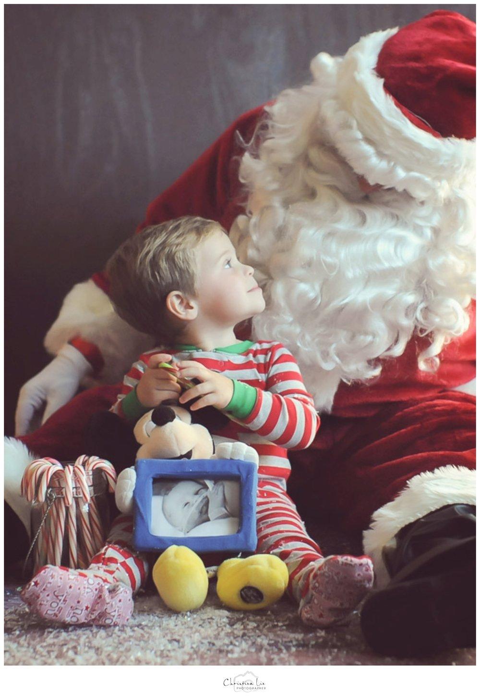 C looking up at Santa w Eli's pic WEB.jpg