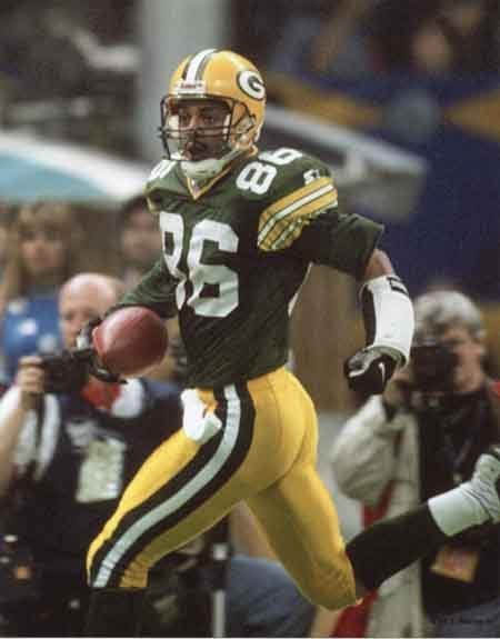 Antonio Freeman scores a touchdown in Super Bowl XXXI