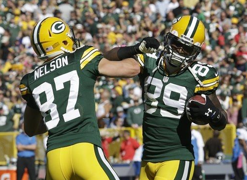 James Jones and Jordy Nelson celebrate a touchdown with the ol' high elbow. (Photo credit: Morry Gash, AP)
