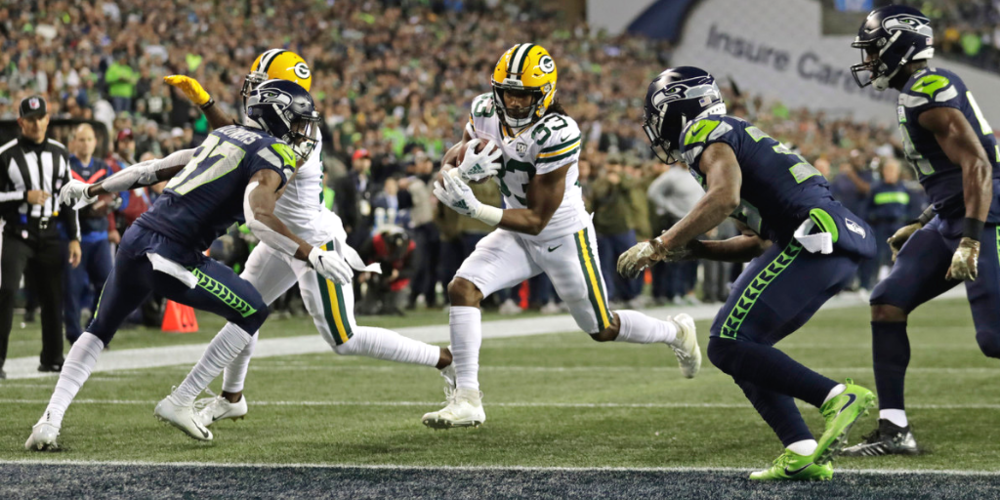 Aaron Jones scored twice and racked up 103 yards from scrimmage, but it wasn't enough for an underachieving Packers team to hold off the Seahawks.