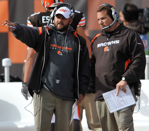 Brian Daboll  (left) coached under former Belichick assistant  Eric Mangini  (right) in New York and Cleveland.