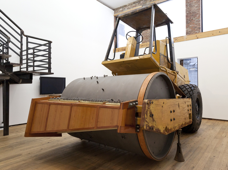 Dave Cole,  The Music Box , 2012, Caterpillar CS-553 Vibratory Roller-Compacter with cherry wood, spring steel and United States National Anthem (arranged for steamroller), 8 x 19 x 11 feet, Courtesy of the artist