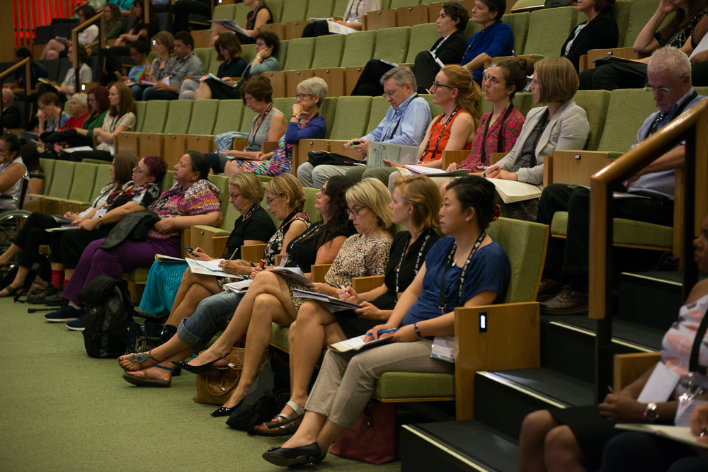 Delegates in the auditorium during a session