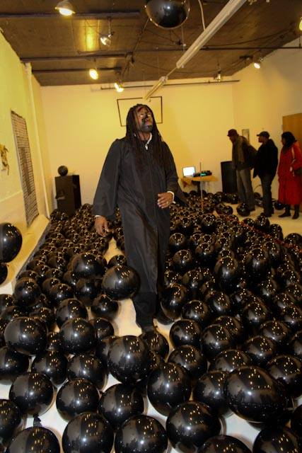 Final Ascension II (performance)  black vinyl, black latex balloons, black robe   2014