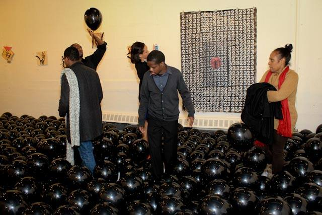 Audience from Final Ascension II  black vinyl, black latex balloons   2014
