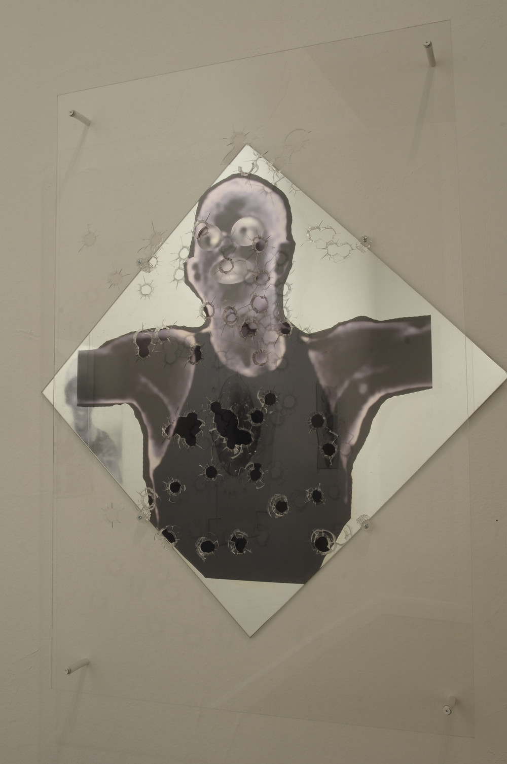 "Take One for The Team  plexi glass, 50mm bullet holes, mixed media on glass  20x20""  2012"