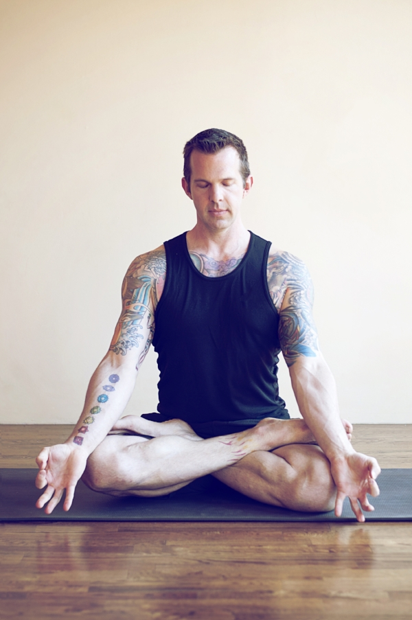 Yoga Teacher Meditating In Padmasana (Lotus) Pose