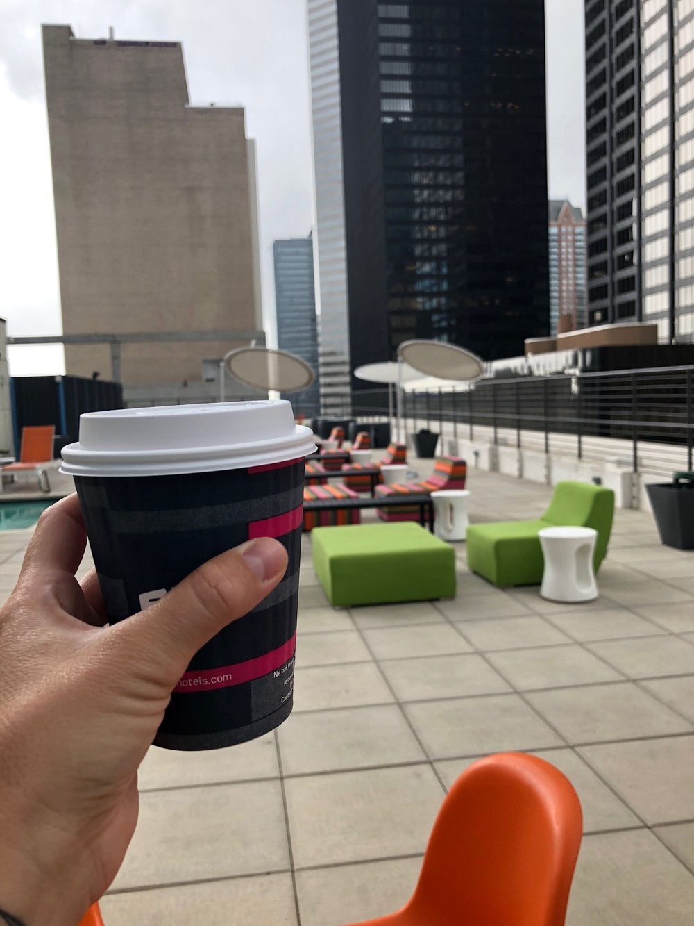 Coffee while checking out the rooftop pool at our hotel
