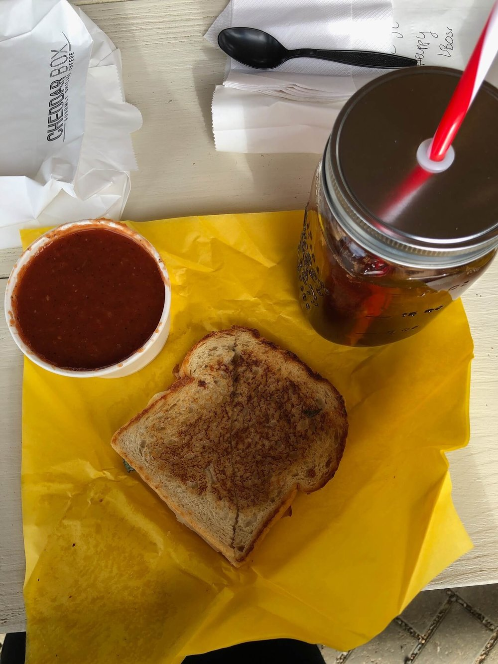 "- We ate at the Cheddar Box, where we all ordered grilled cheeses and tomato soup. As a grilled cheese LOVER, I really enjoyed my ""Boss"" grilled cheese. The soup was a little chunky for me, but was still perfect for dipping my sandwich into."