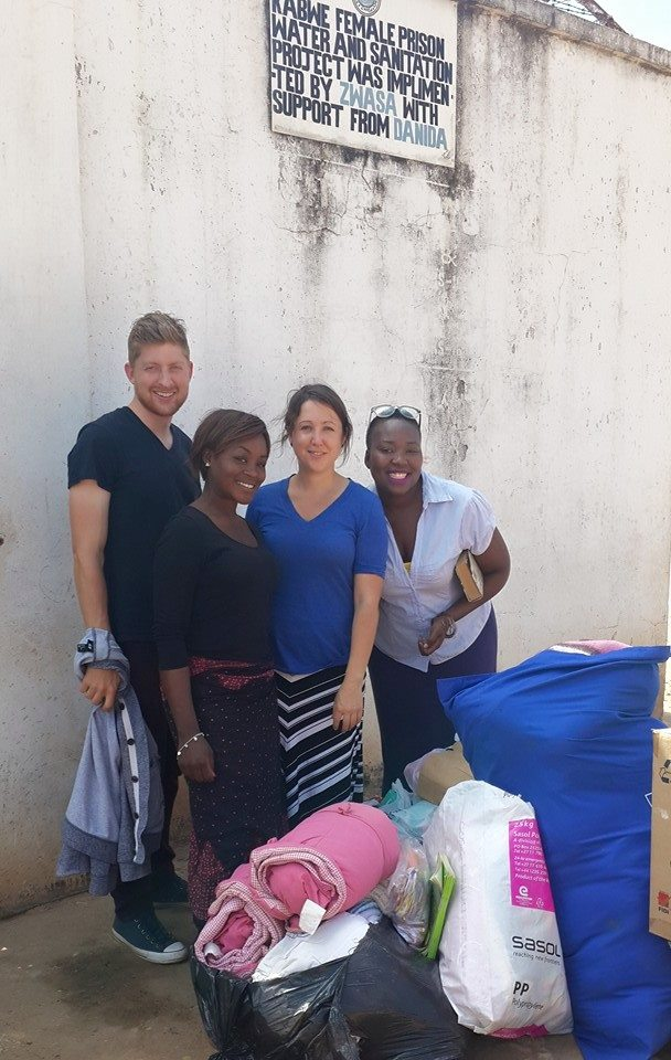 Adam (far left) with UP Zambia volunteers delivering blankets and food donations for the babies and the juvenile girls in Kabwe Female Prison.