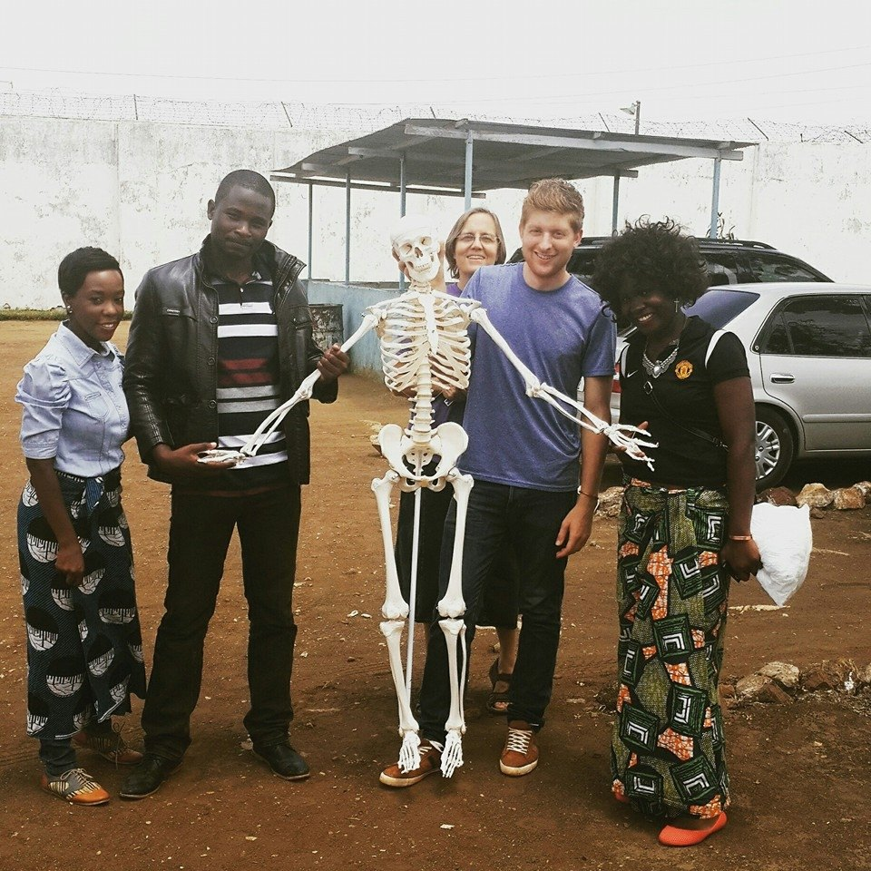 Adam (second from the right) prepares for a science lesson with other UP Zambia staff and volunteers outside Kamwala Remand Prison.