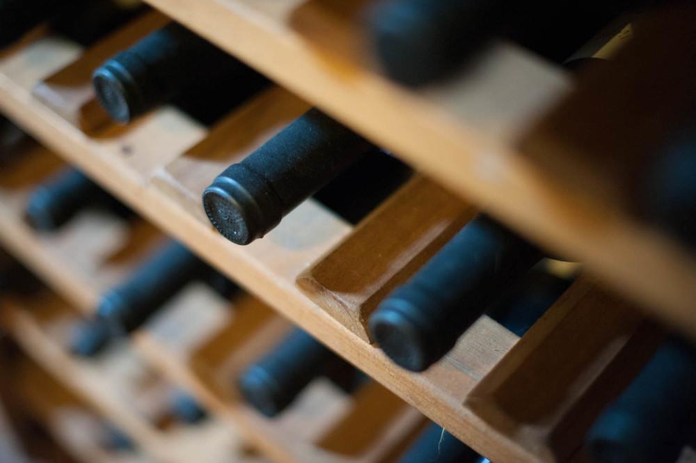Bottles of Wine in a Rack at Estancia Los Potreros