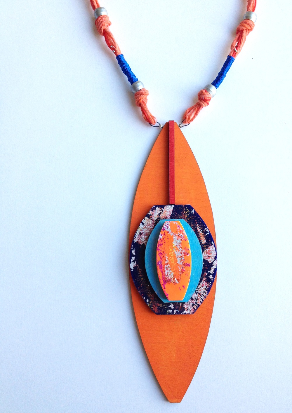 HannahMiles-african sky and dust neckpiece-lasercut pine,acrylic,printedfoiling,dyedstring,painted jump rings,crimp beads-necklace pendant dimensions 21cmx6.5cm, total length of piece inculding cording 42cm.jpg