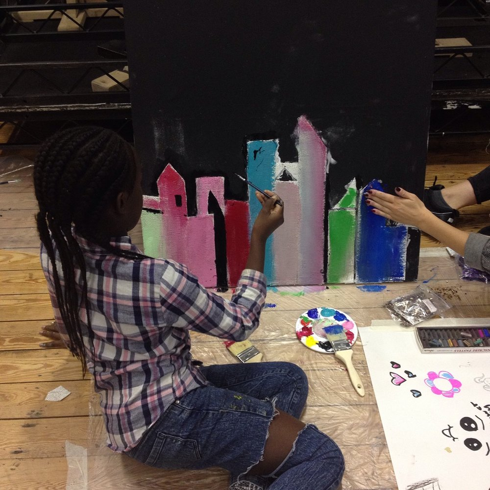 young people making a collaborative canvas during half term at an XLP creative workshop