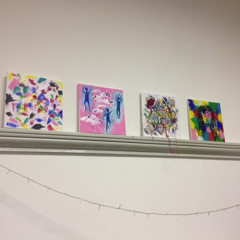 expressive canvases painted by young people during an arts workshop