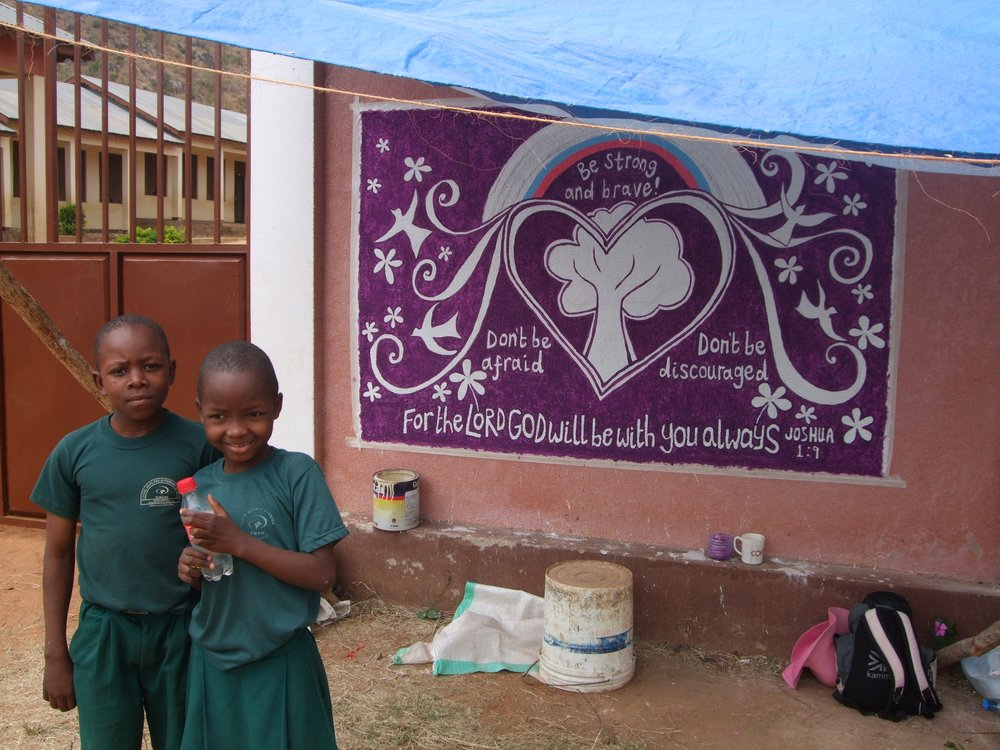 school kids checking out the mural's progress at Living Hope pre and primary school in Tanzania