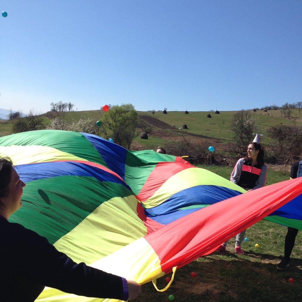 parachute games at community fun day at Casa Harilui, Romania