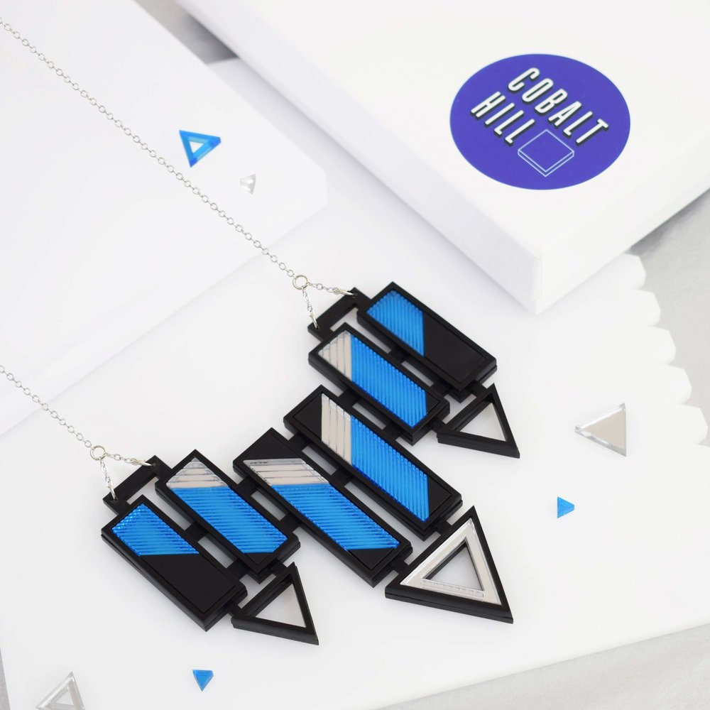 Arrow-Bar-Large-Bib-Necklace-Blue-and-Silver-laser-cut-acrylic-necklace-Cobalt-Hill.jpg