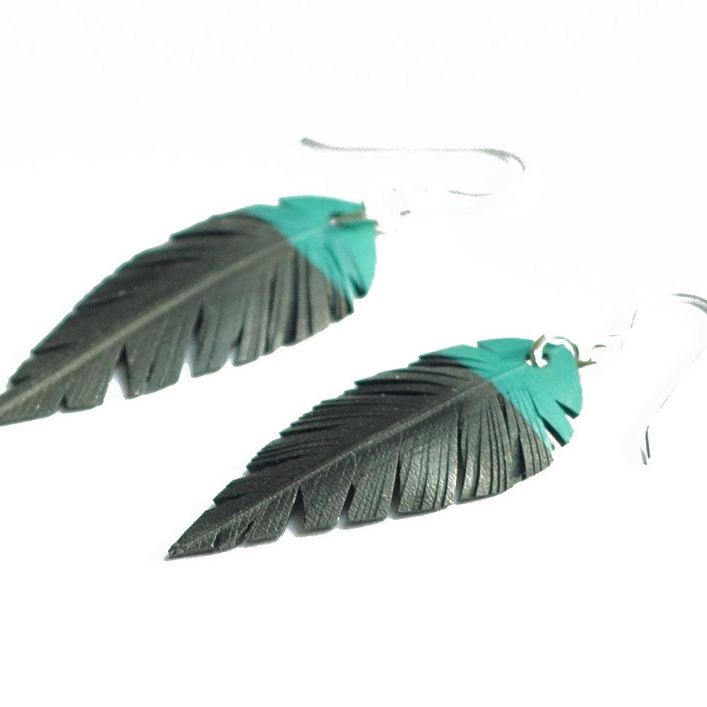 Inner tube earrings teal top.jpg