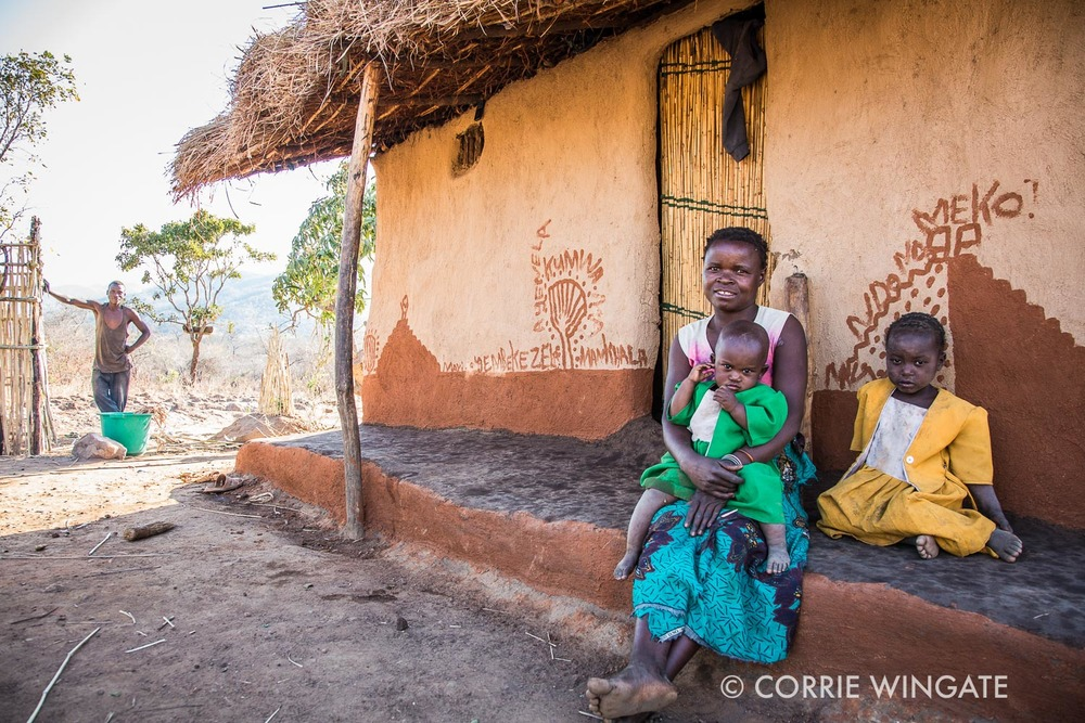 Mother, children and husband in background, rural scene, Kalonga village, Salima distict, Malawi
