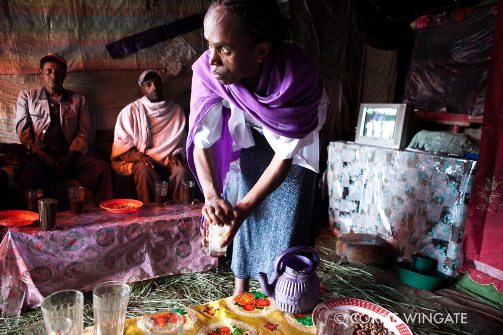 PMCT memeber with using microfund to brew own beer, Kuy health centre, Debaytilatgin Woreda, Amhara region, Ethiopia, Africa