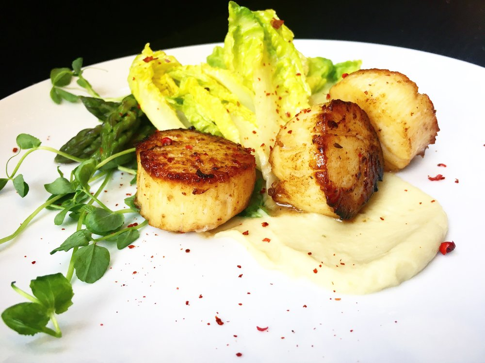 Seared Scallop salad with Poached asparagus and white bean puree