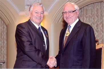 Professor Sensei Ramon Lawrence OAM receives his OAM from the Governor of Western Australia (General) Sir Zelman Cowan