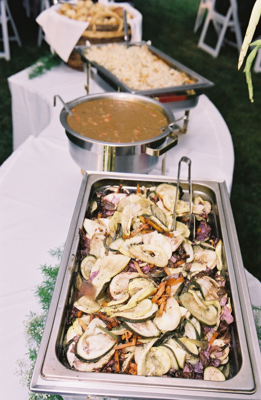 stew and fresh roasted vegetables catering setup