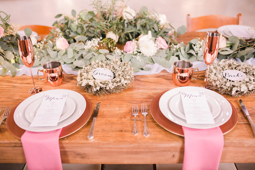 Wedding set table with menus placed on the plates. Well set by the caterers.jpg