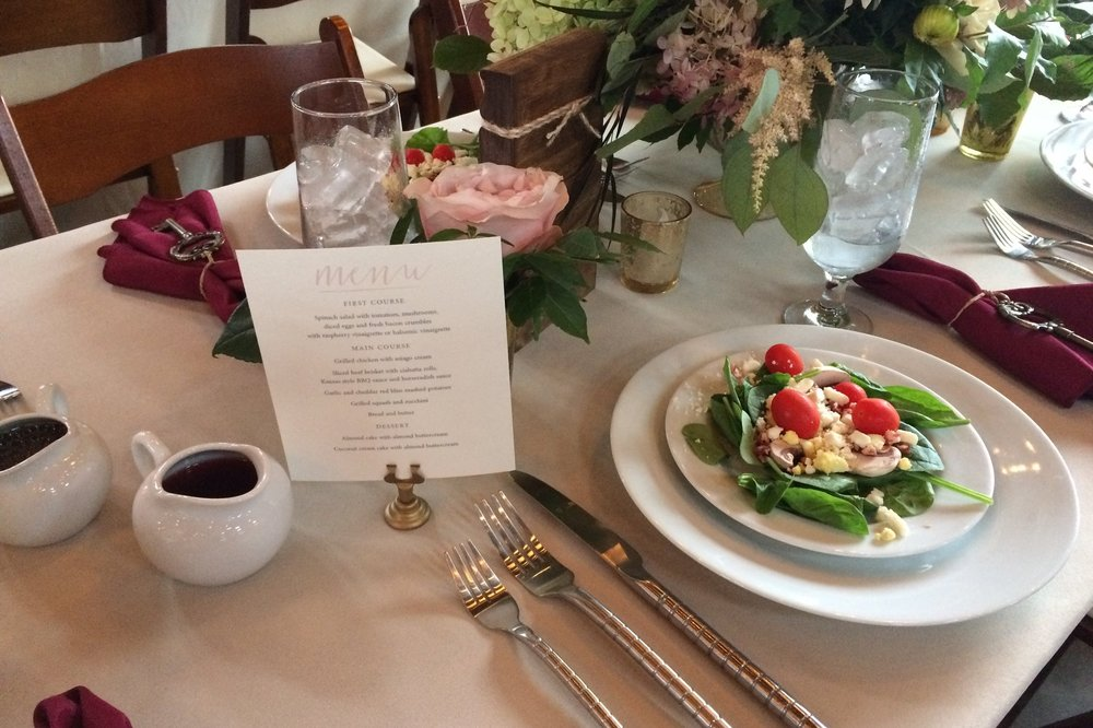 Salad on a plate with a well set table for a multiple course meal at a wedding.JPG