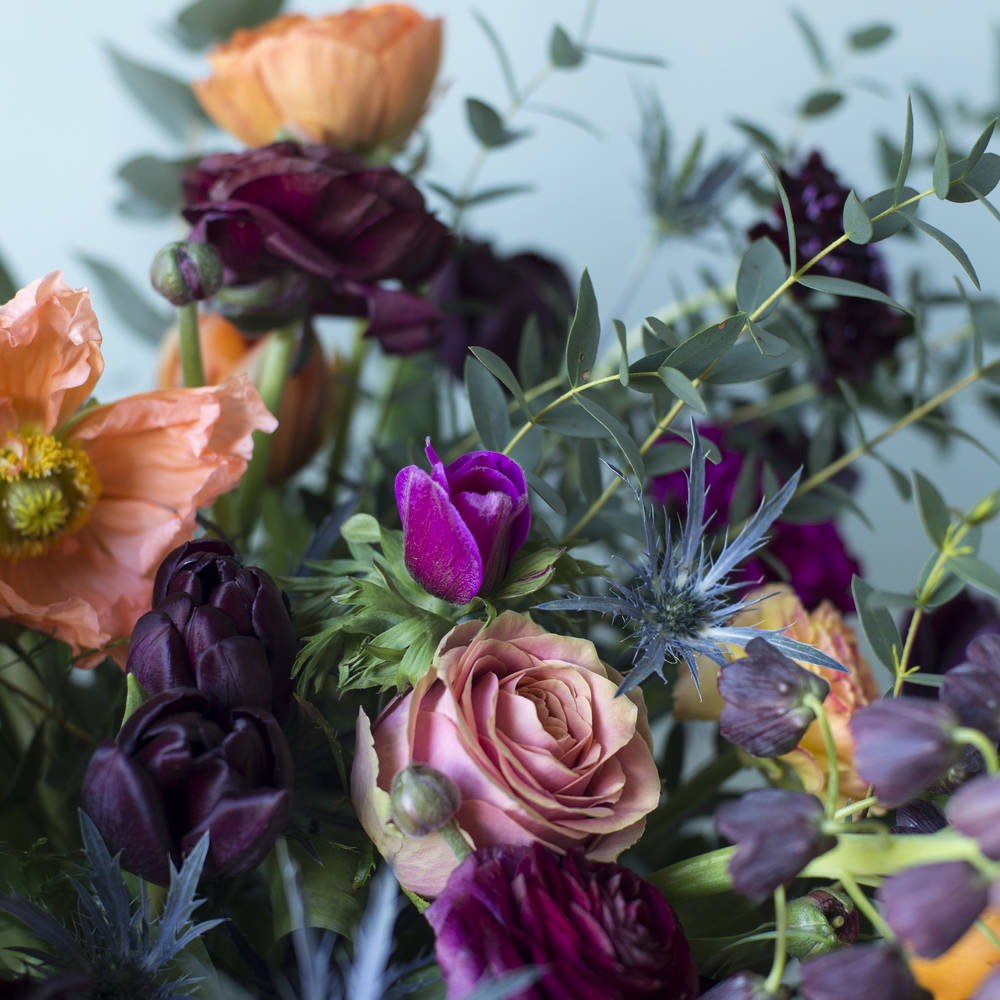 Poppies, Fratillaries, Anemones, Orange ranunculus & thistles