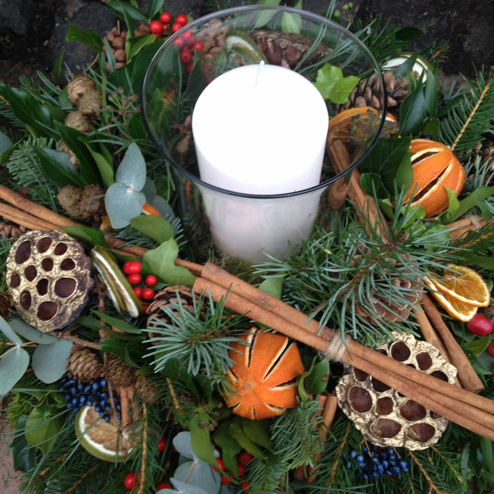 Wreath candle design Cinnamon, Verbena Berries, lotus pods, eucalytus, dried oranges, holly berries, pine, spruce