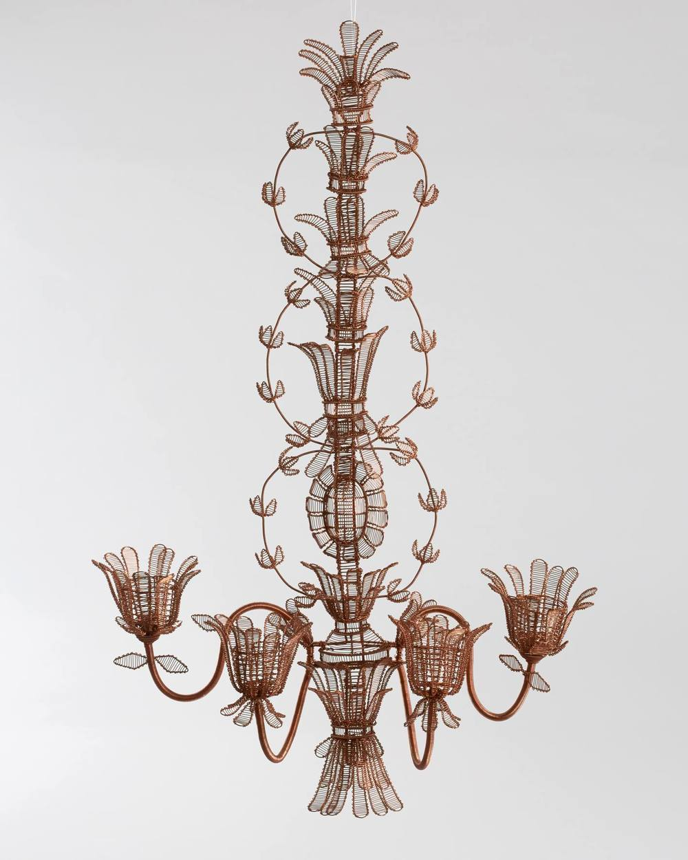 The Copper Madame Filigree Wall Sconce    This wall sconce was inspired by the carved gilt wall sconces that Robert Adam designed for grand English homes in the late 18th Century. Reimagined in fine filigree wire-work that was collected by the likes of Catherine the Great at the time, these sconces are made entirely by hand in copper wire.  R4200   *The sconces can be fitted with electricity and small light bulbs