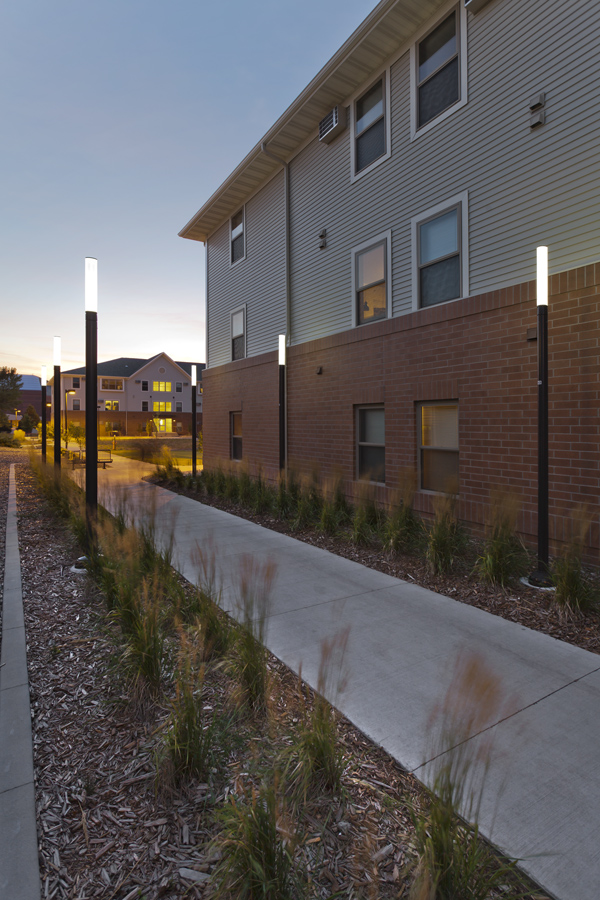 Native grasses line the apartment landscapes and sidewalks