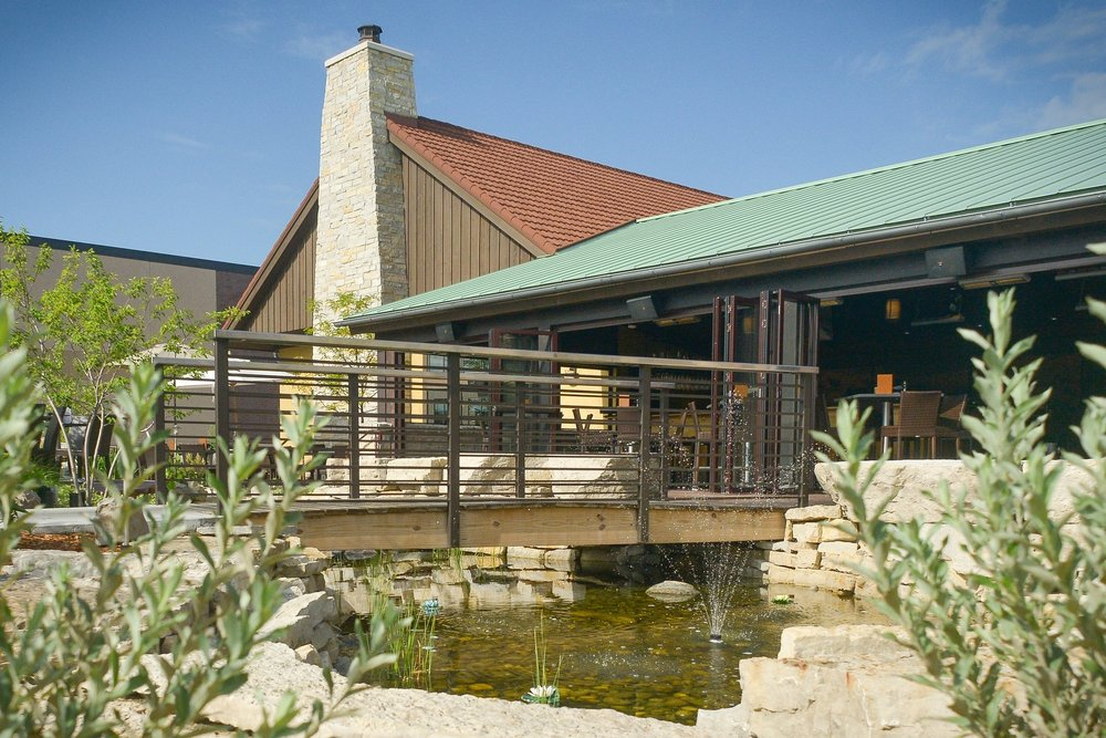 This project also included a bridge over the stream for customers to cross on their way to be seated at a table.