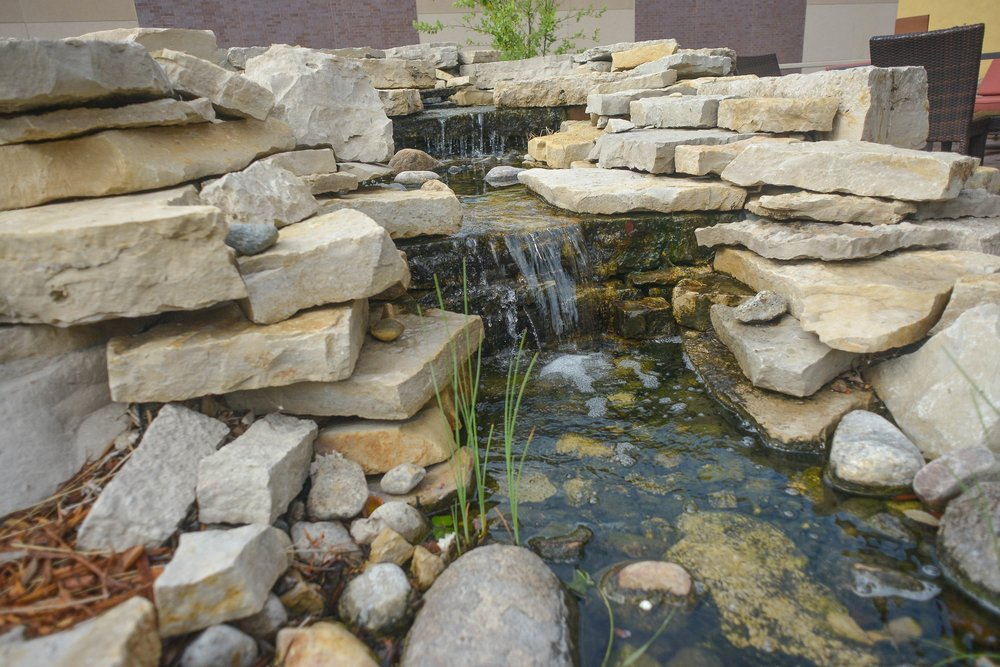 The fountain and stream on the back patio of Porter Creek Hardwood Grill creates an outdoor oasis for guests.