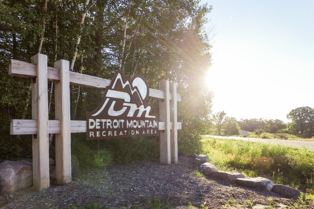 Detroit Mountain Recreational Area has hiking and biking trails in addition to ski and snowboard runs. This sign was designed with goals of matching the natural environment that surrounds it.