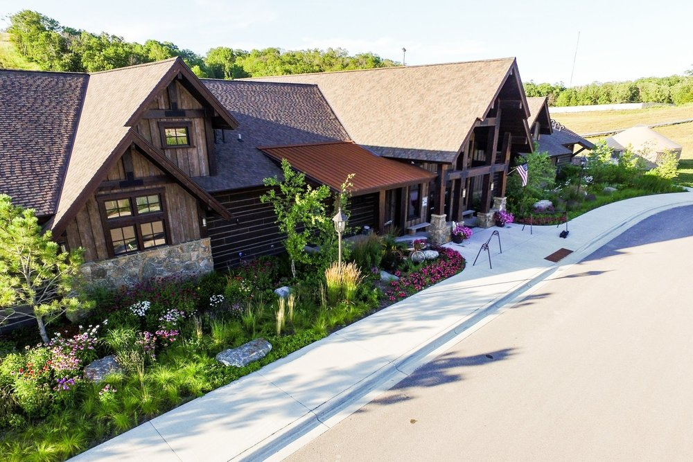 The lodge is surrounded by native grasses, trees and perennials.