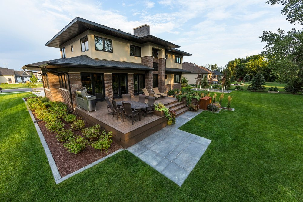The design for this modern craftsman style home in Fargo was inspired by the strong lines in the architecture, which were then reflected onto the landscape.