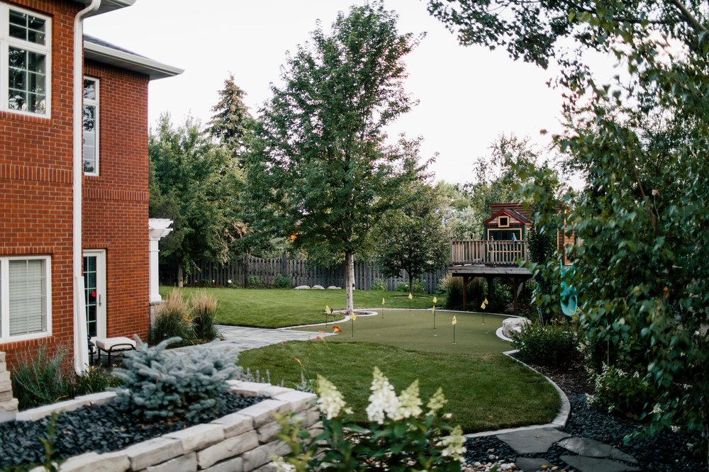 The lower yard offers amenities to appeal to the kids, like the custom designed playhouse, putting green, and plenty of pace to run.