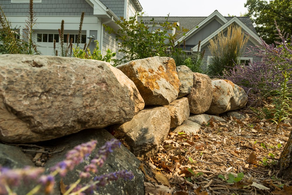 Natural stone outdroppings brings out the natural look of the home.