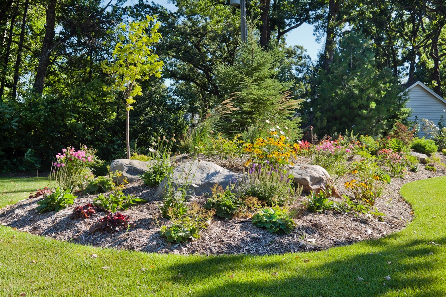 Landscape bed at the entrance of the driveway.