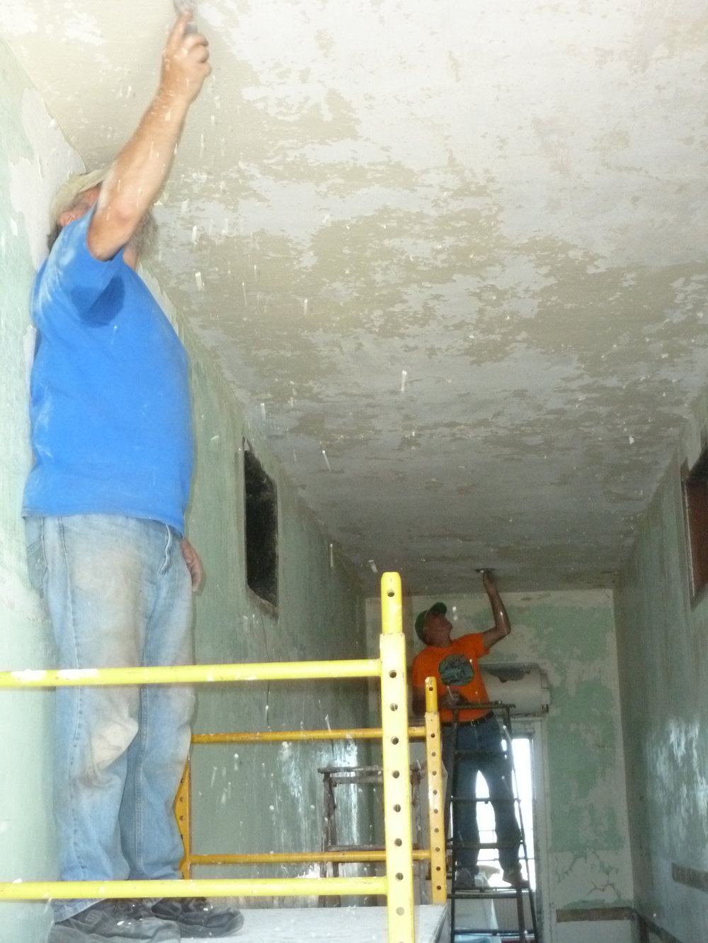 Bob and Jim hard at work scraping the ceiling