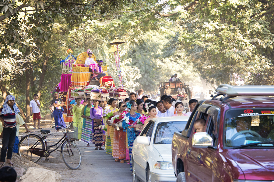 Burmese people in a Buddhist Shinbyu procession celebrating a boy becoming a monk in Myanmar