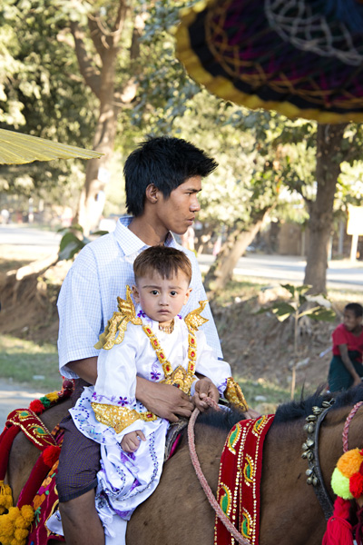 Young Burmese Boy on his way to become a monk in a Buddhist Shinbyu procession in Myanmar