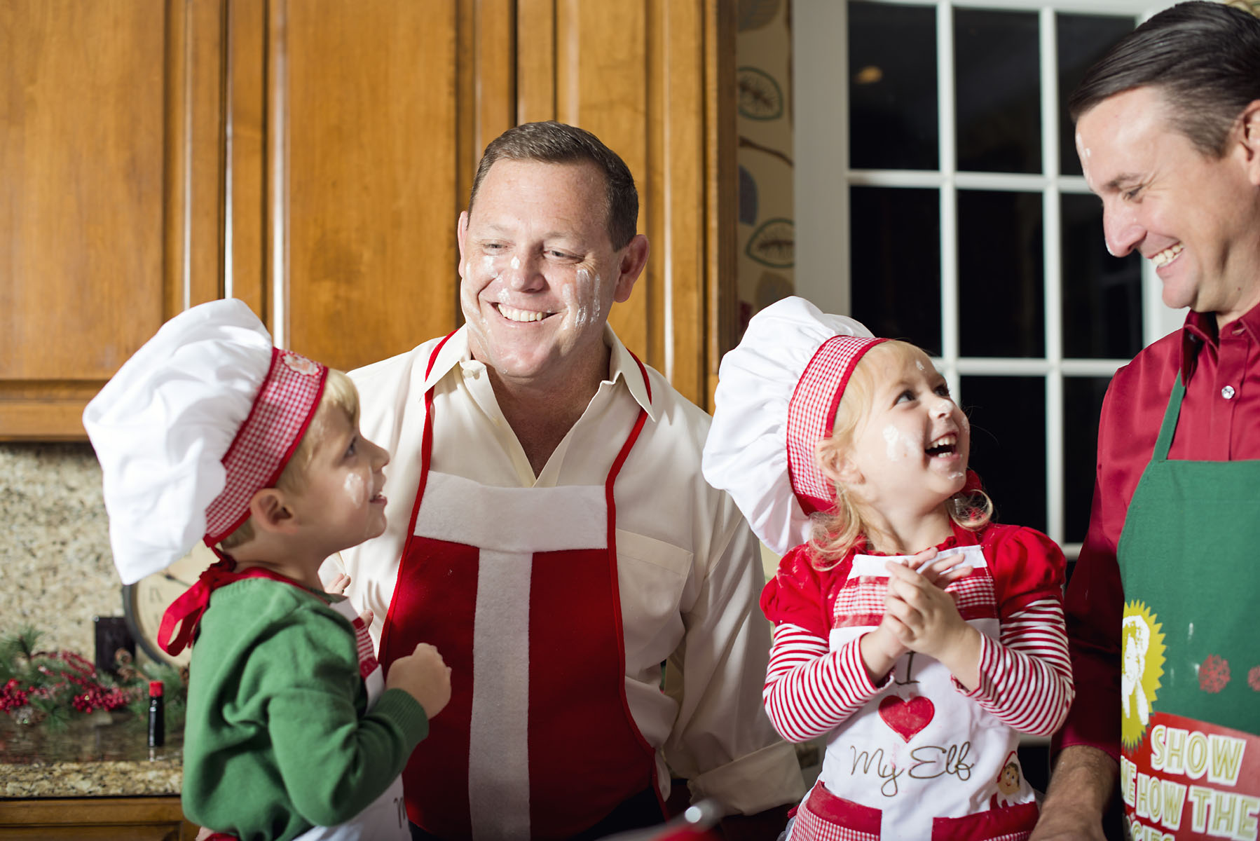 father and children baking christmas cookies