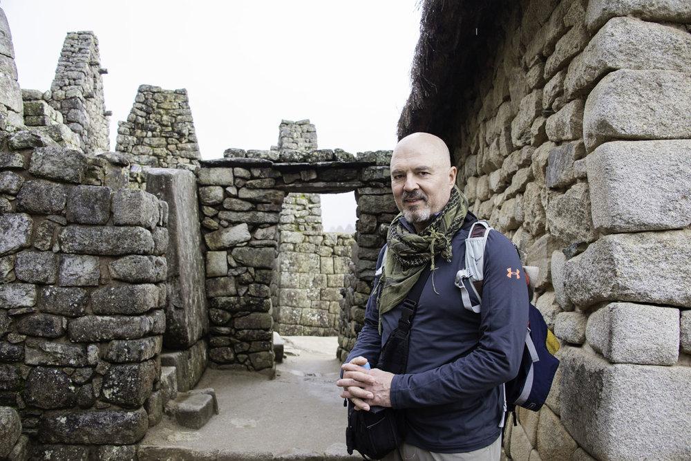 Hiker Posing with Block Walls at Machu Picchu