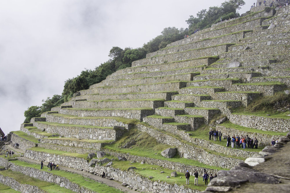 People on Stairs at Machu Picchu